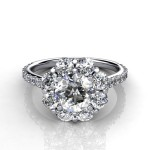floral designed ring with a round brilliant criss cut center stone surrounded with smaller round diamonds